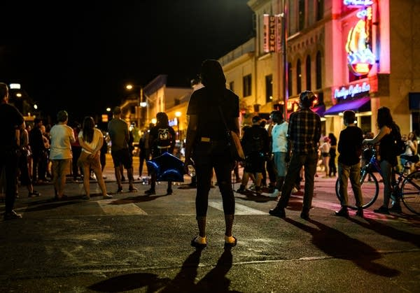 A group of people stands in the street