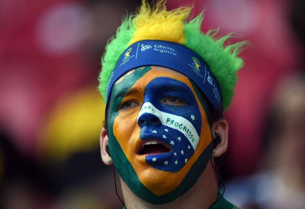 A Brazilian fan waits