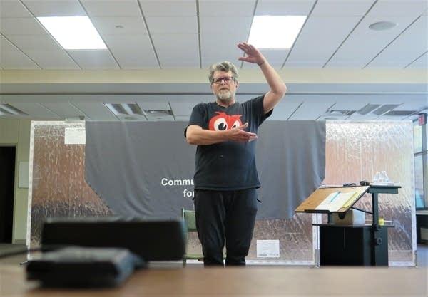 A man teaches an exercise class online