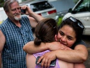 Antonia Alvarez hugs a fellow resident.