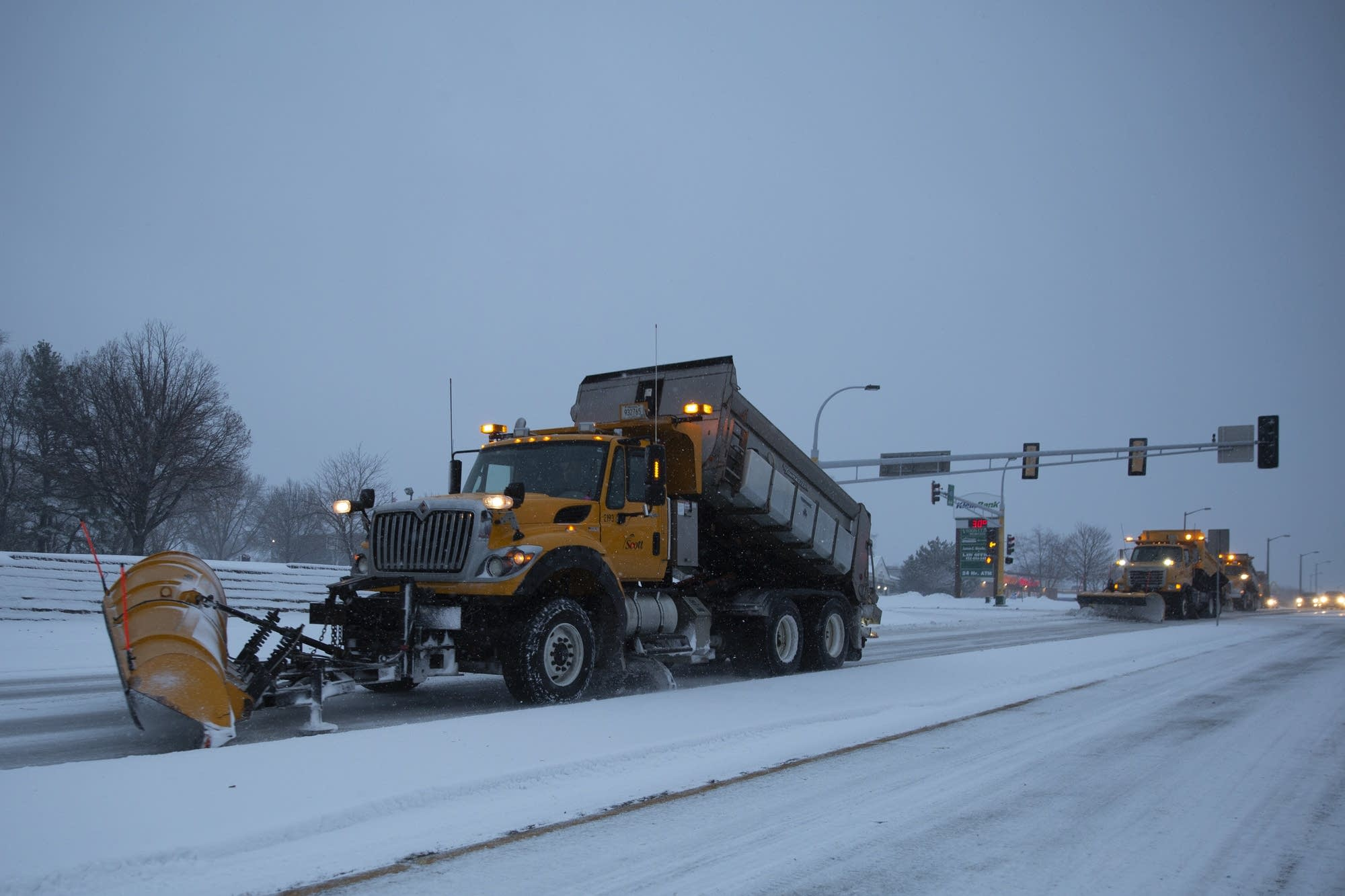 Road crews drive down County Road 42 in Savage.