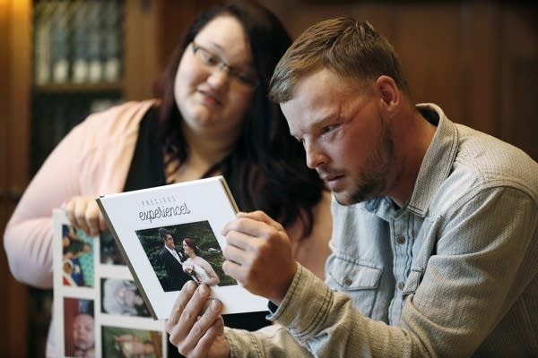 Lilly Ross, left, shows her family photos to Andy Sandness.