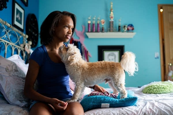 Calonna Carlisle and her 12-year-old dog Pluto.