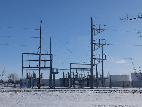 power poles and lines in a snowy field