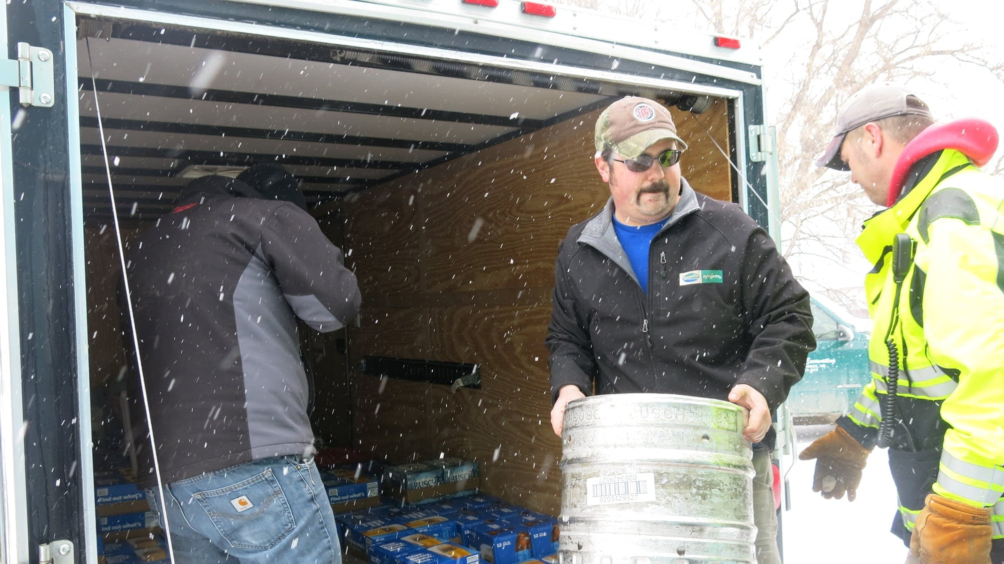 Tim Solem moves a keg of beer into Jamieson's Bar in Oslo, Minn.