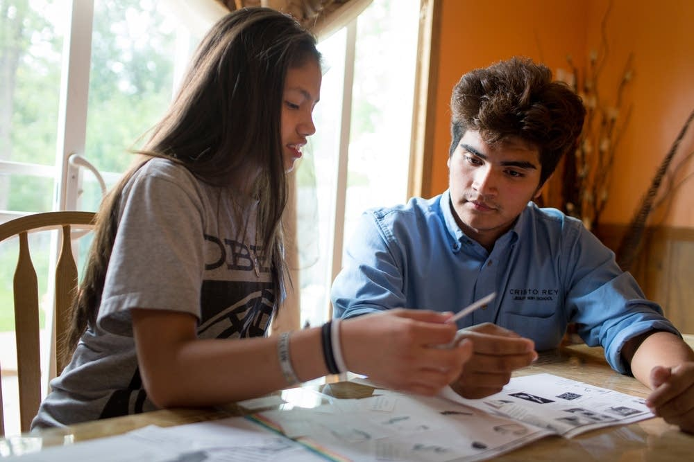 Joshua Crespo tutors his sister at home