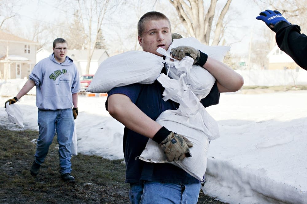 Carrying sandbags