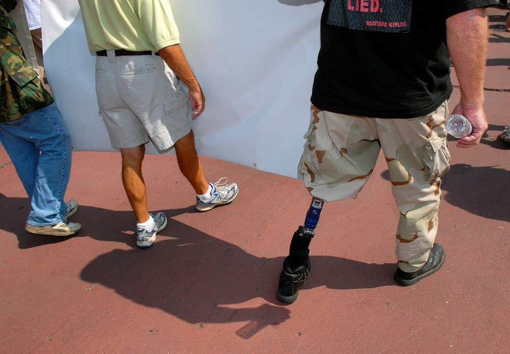 A legless marine participates in the protest march