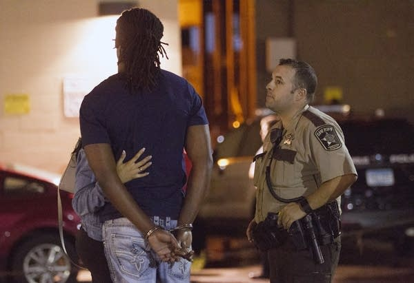 A Hennepin County sheriff listens as a suspect describes an altercation.