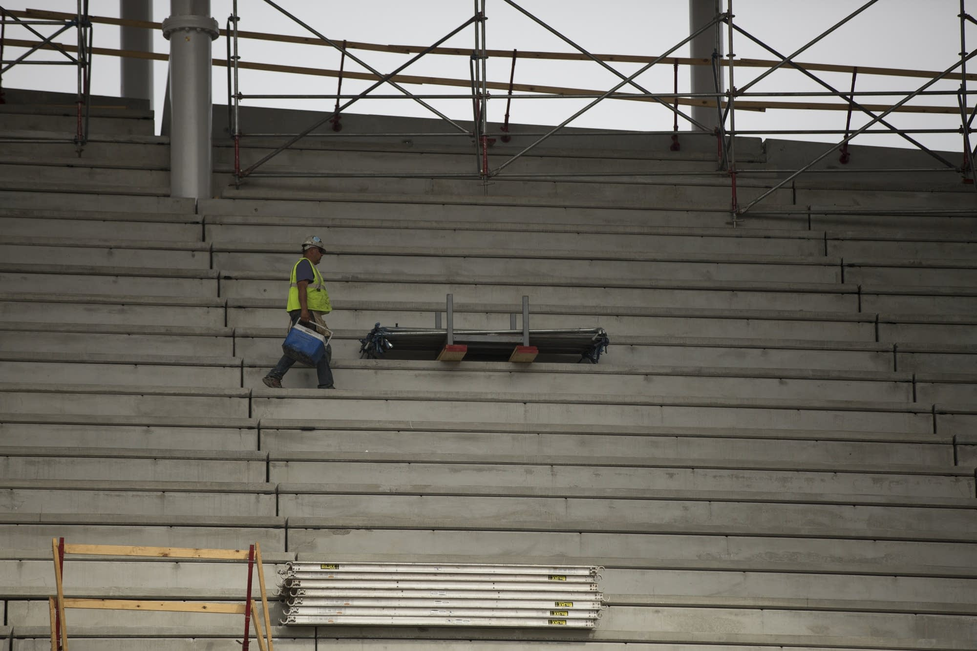 A construction worker heads for the exit while working at Allianz Field.