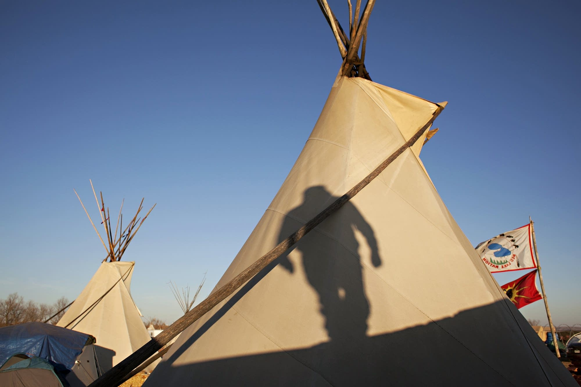 Frank Sander's shadow graces a tipi