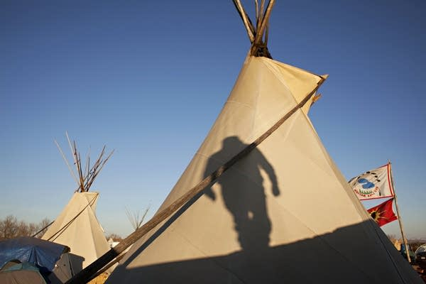 Frank Sander's shadow graces a tipi.