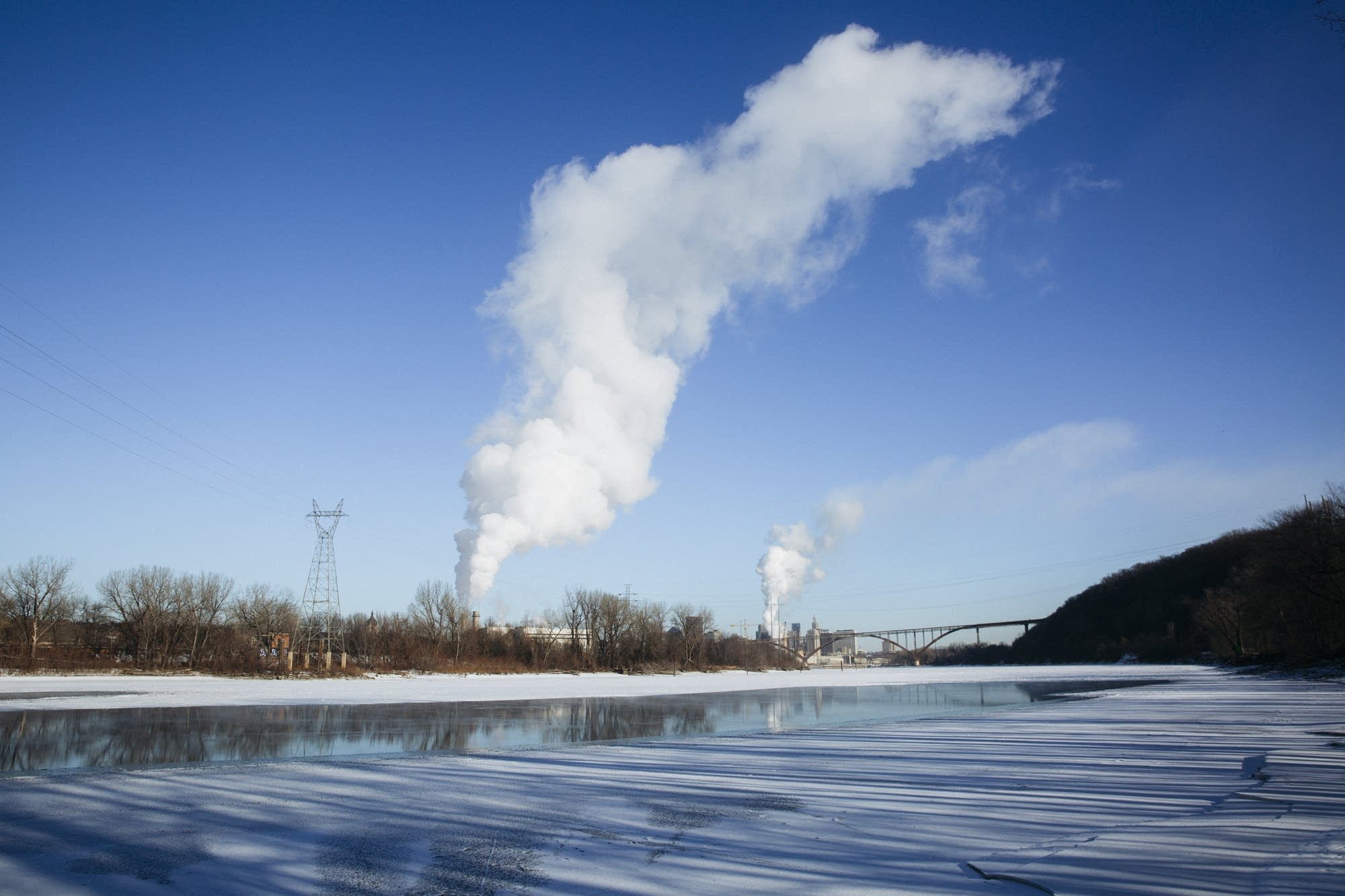 Plumes of vapor rise above the Mississippi River.