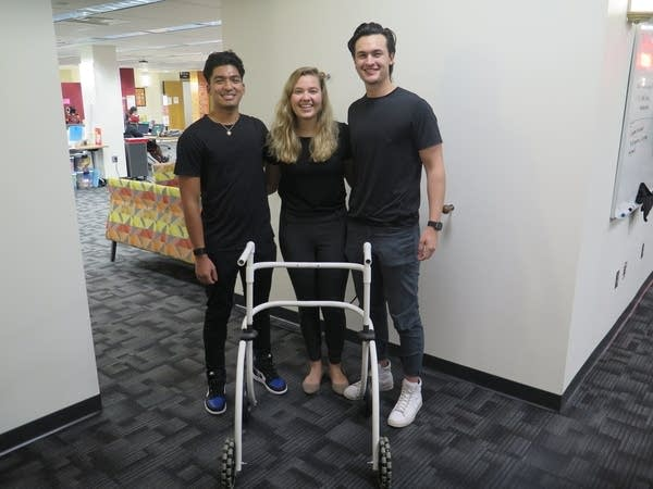 Three people standing together
