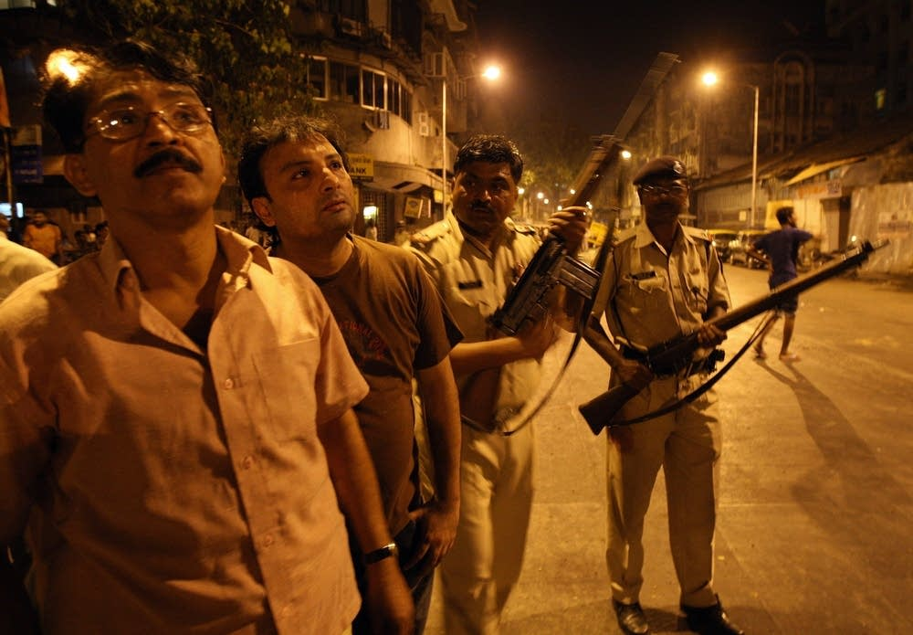 Indian policemen prepare to take position