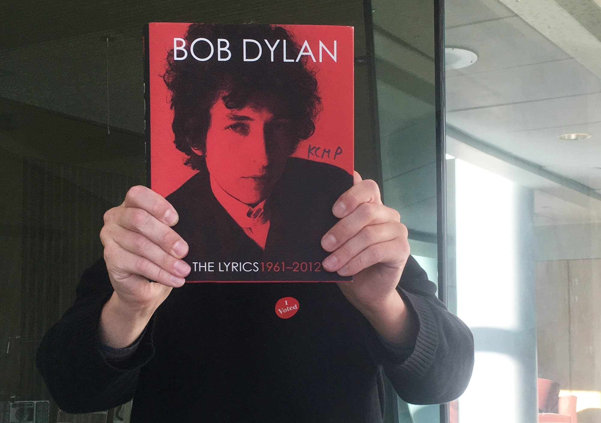 Jay Gabler holds Dylan's 'Lyrics 1961-2012'
