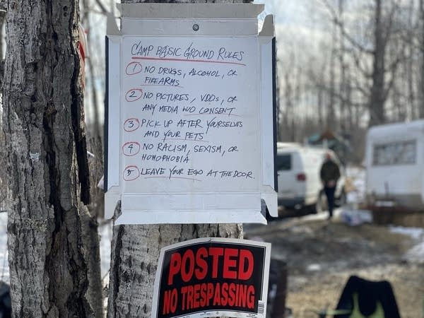 Instructions for visitors to Camp Migizi hung on a tree outside.