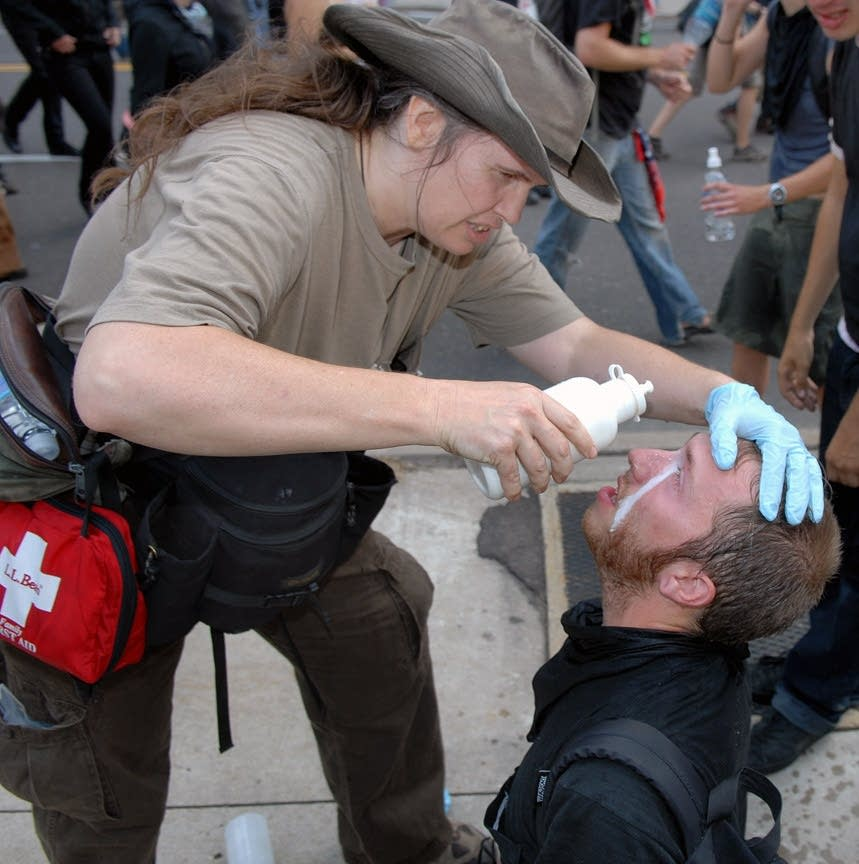 A protesters is injured by tear gas