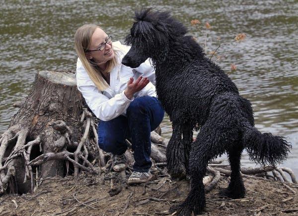 Ahna Brutlag and her poodle Monty at the dog park.