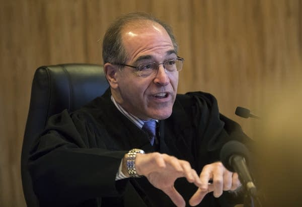 Chief Judge John H. Guthmann speaks during a motion hearing.