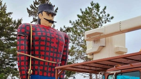 An image of the Paul Bunyan statue with damage to one arm