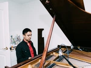 Vijay Iyer playing piano at home