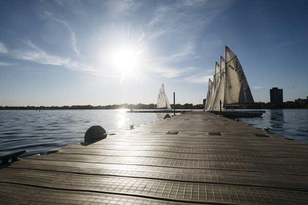 The sun shines on the sailboat dock on Lake Calhoun.