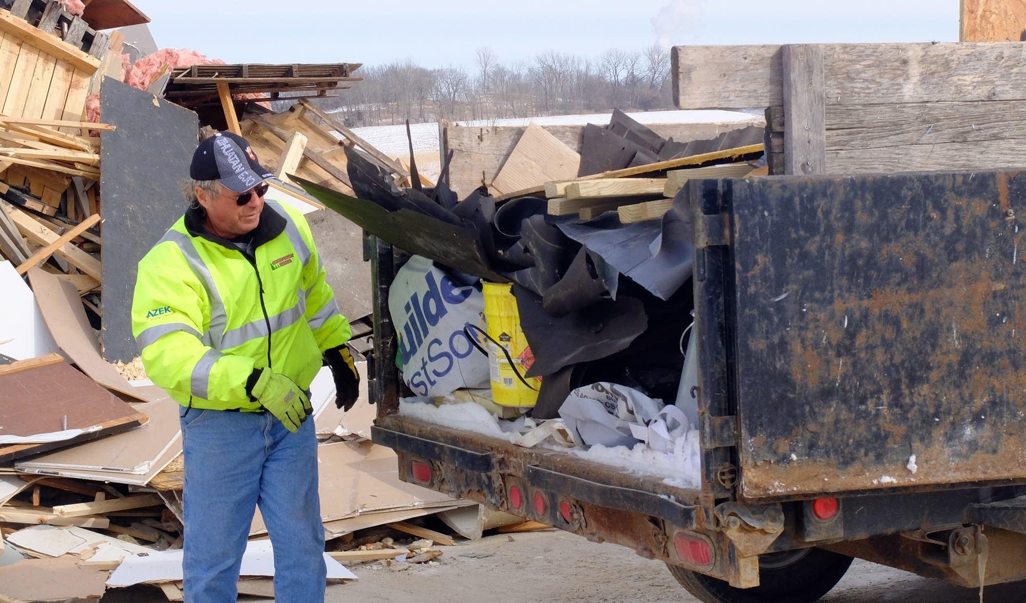 Contractor Daryl Jensen prepares to unload construction debris.