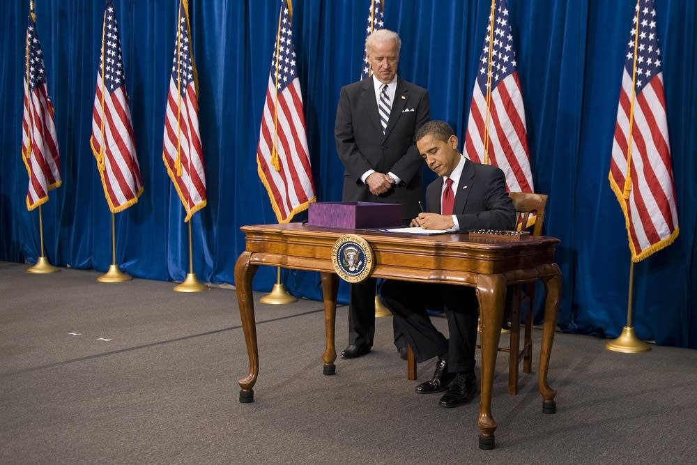 President Obama signs the stimulus bill