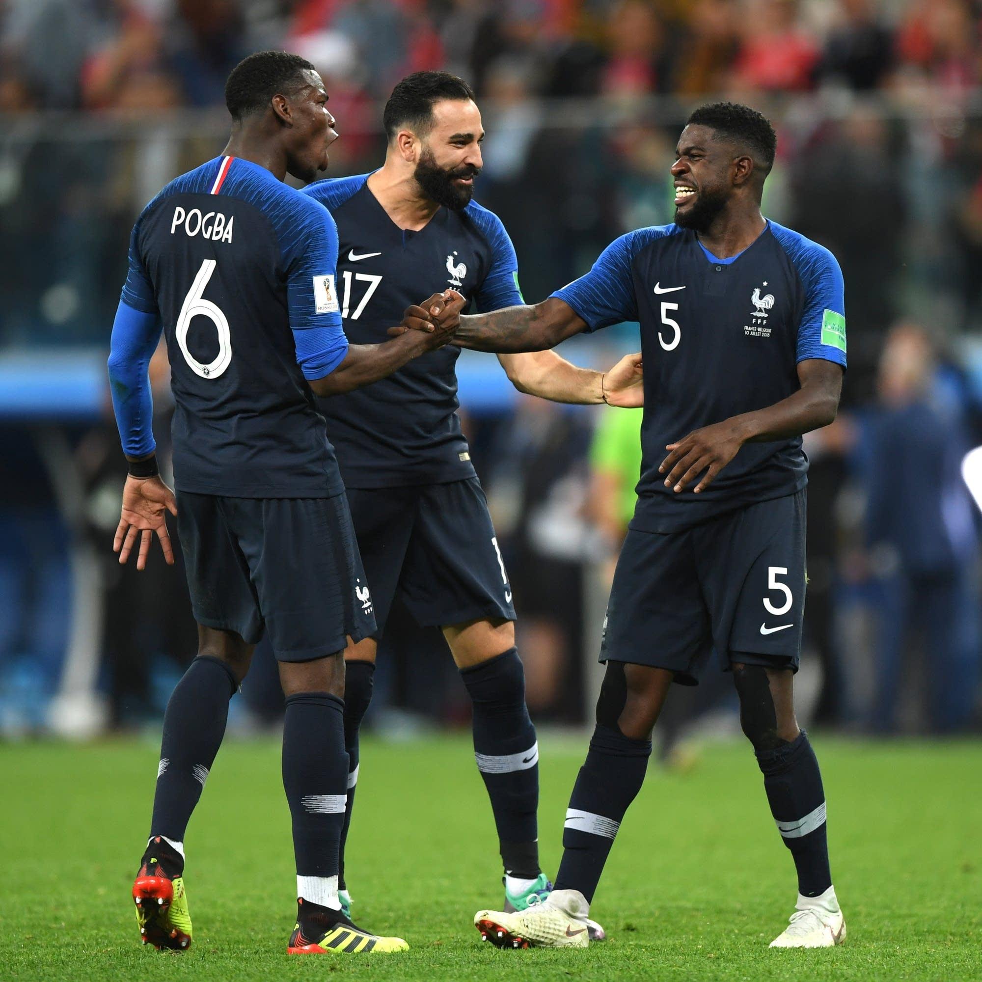 Paul Pogba, Adil Rami and Samuel Umtiti of France celebrate.