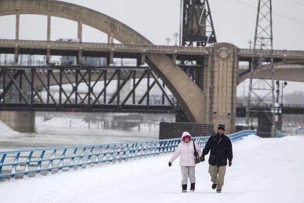 Delmy and Luis Muniz walk to work in the snow.