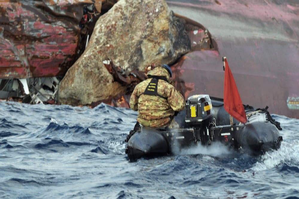Rescue teams approach the Costa Concordia