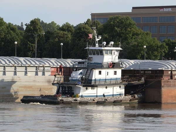 The towboat Itasca moves barges on the Mississippi River in St. Paul.