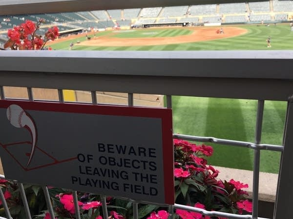A sign with a message at a baseball stadium