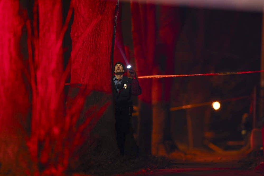 Minneapolis police officer investigates shooting.