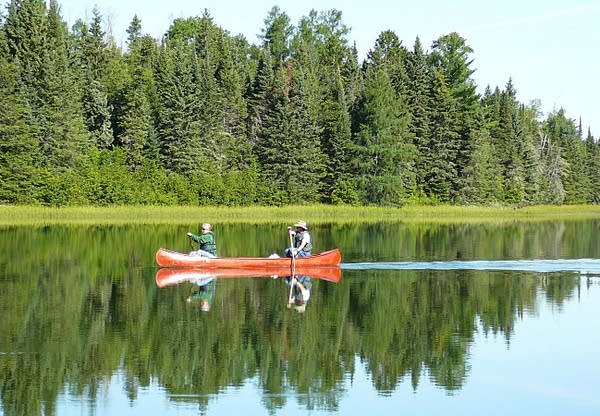 Canoeists paddle across Lake Itasca in Itasca State Park.