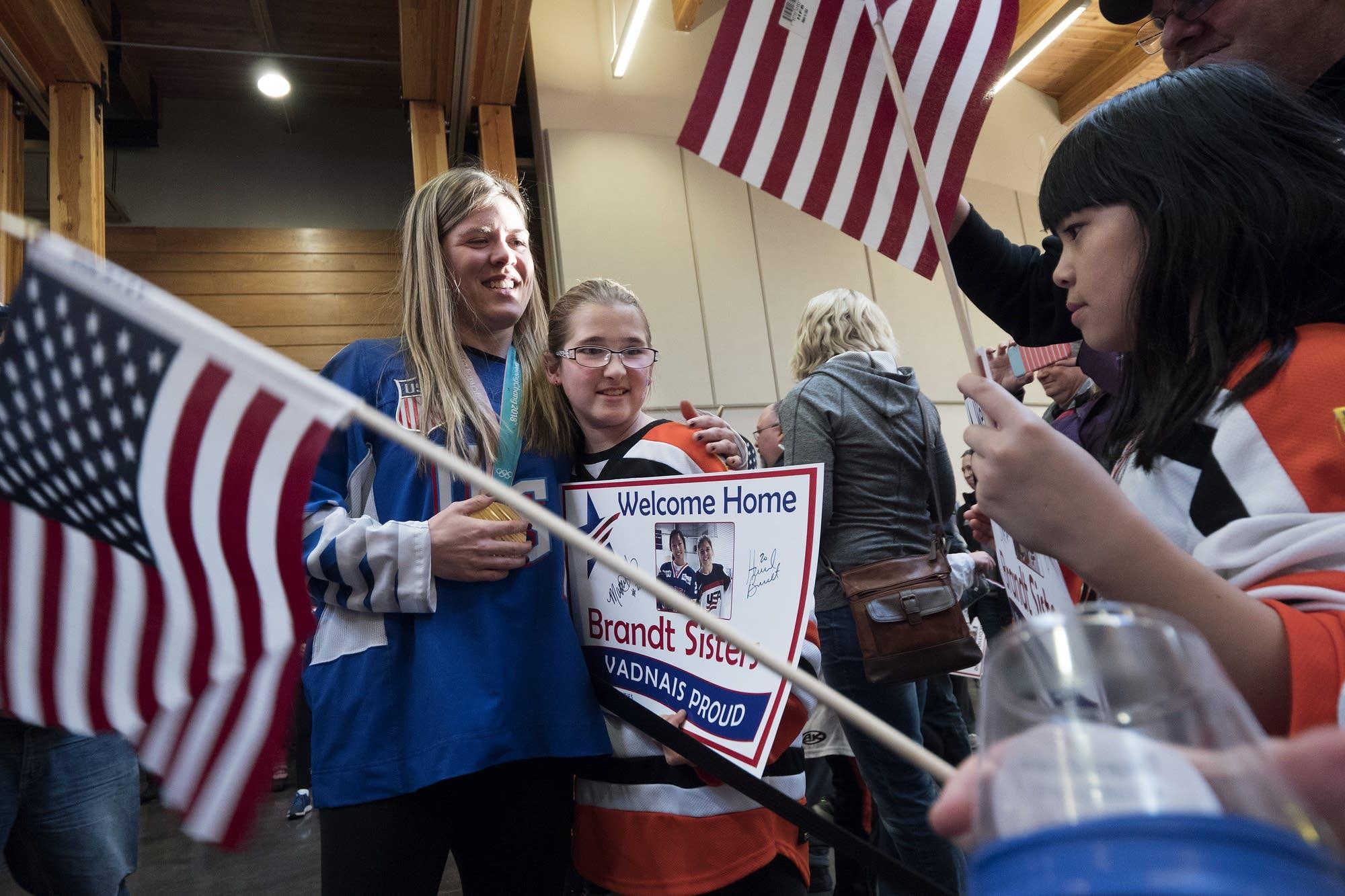 Hannah Brandt hugs a fan.