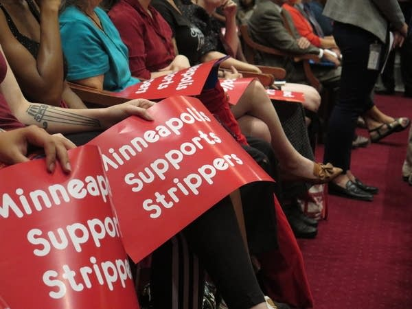 Supporters of rules for strip clubs at Minneapolis council meeting.