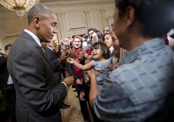 President Barack Obama is given a rose