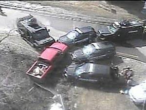 Law enforcement vehicles surround a pickup truck