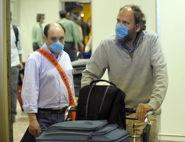 Air passengers wear masks