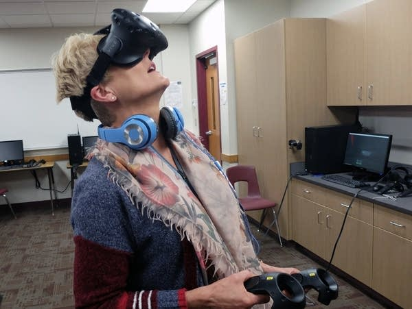 Elementary teacher Tracy Baxter tries out virtual reality goggles.