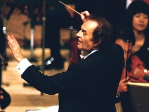 Conductor Charles Dutoit performs with NHK Symphony Orchestra in Tokyo.