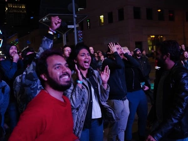 Virginia fans Ram Mudda, left, and Jill Pavagadhi celebrate