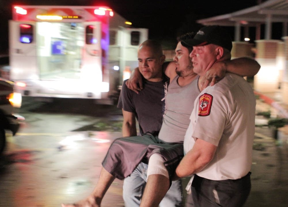 Carrying injured man after tornado