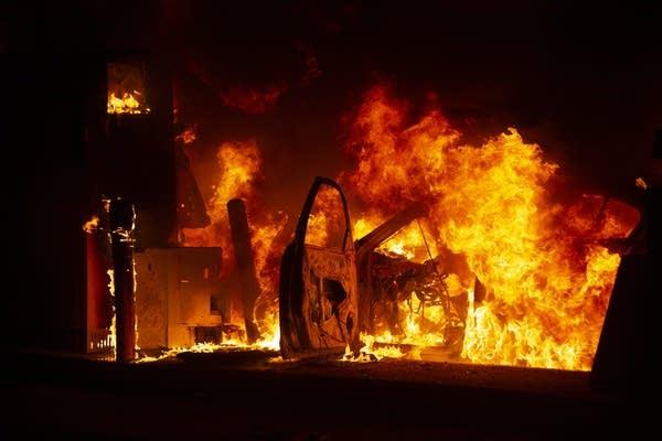 Burning car in Wells Fargo drive-thru.