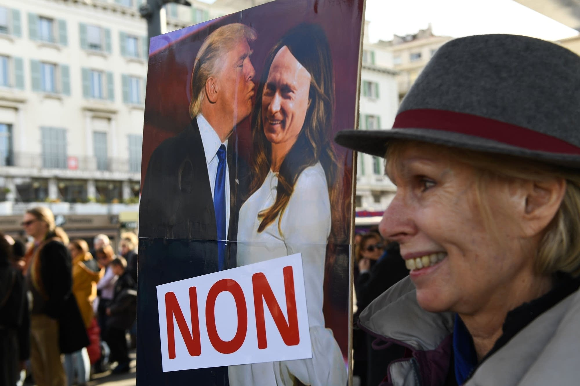 Marseille, France: A protestor holds a placard of Putin and Trump.