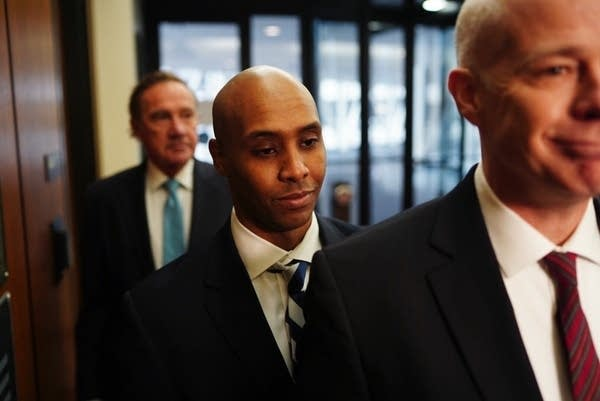 Mohamed Noor walks into the Hennepin County Government Center.