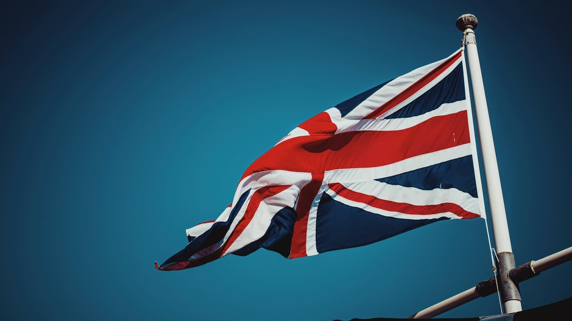 A British flag waves in the wind.