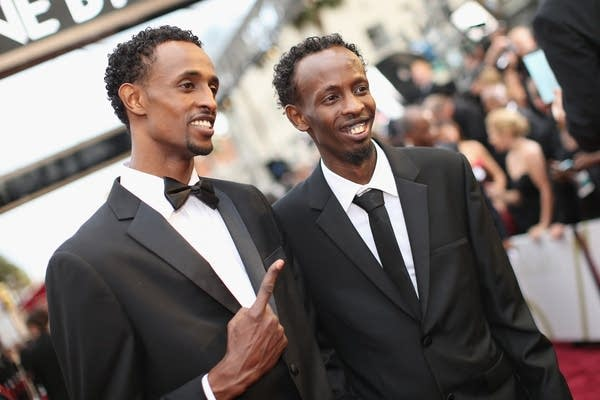 Faysal Ahmed, left and Barkhad Abdi attend the Oscars.